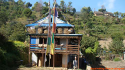Traditional nepali house with drying food grains
